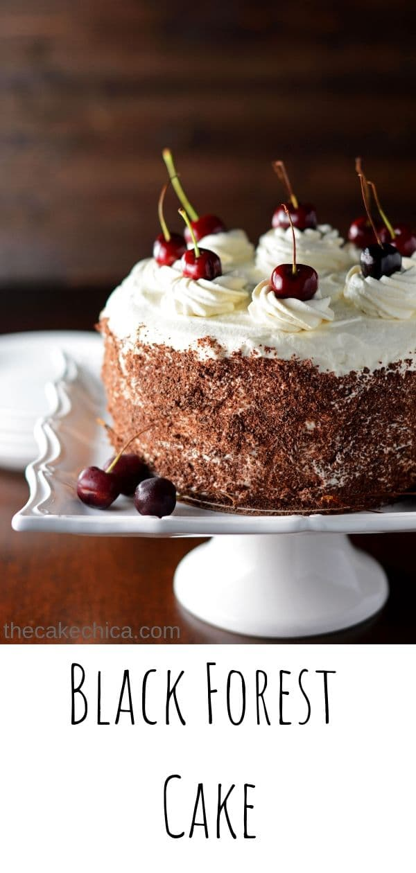 Four layers of chocolate cake moistened with a soaking syrup and filled and frosted with whipped cream and decorated with grated chocolate and fresh cherries.